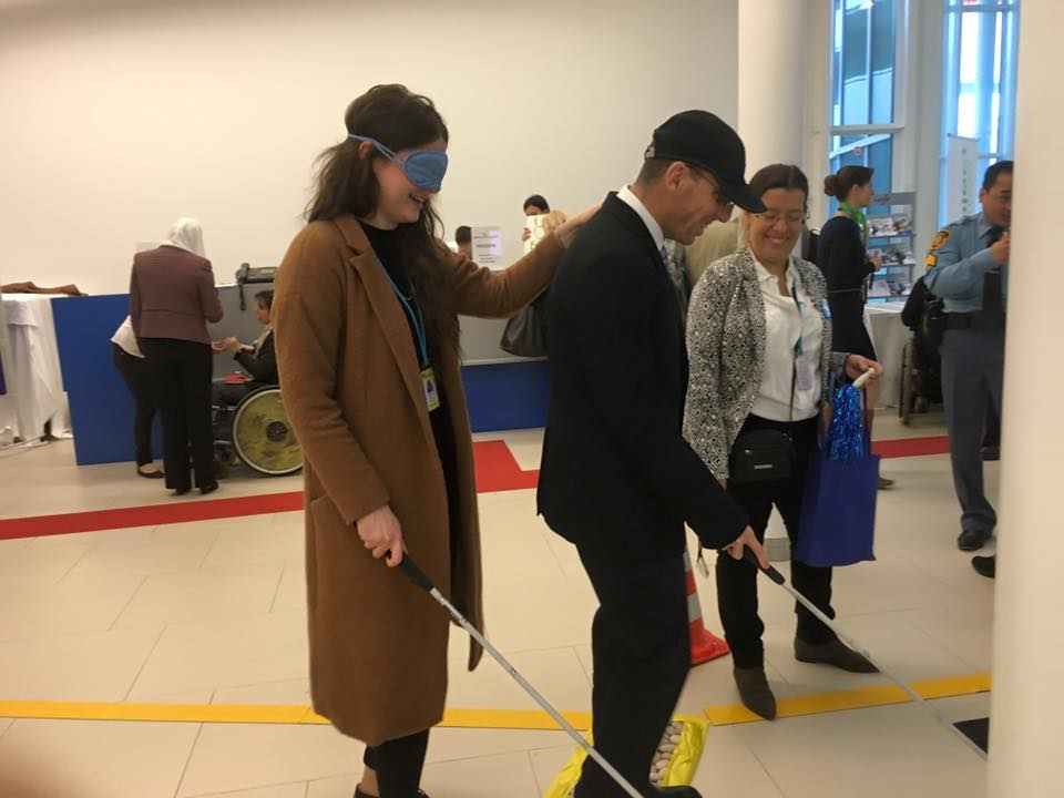 two participants walk with blindfold and blind walking stick
