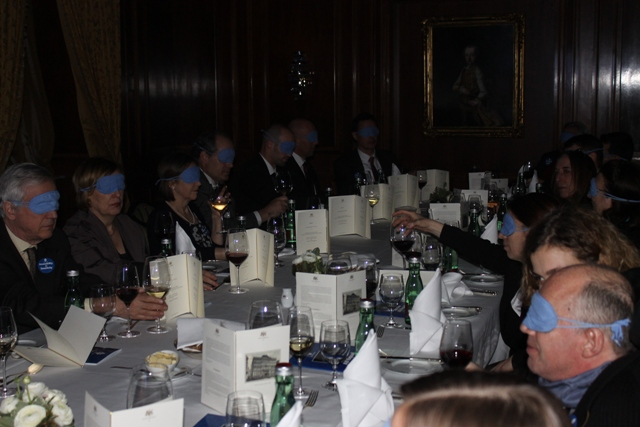Participants at the Meal of the Senses eat with blindfold