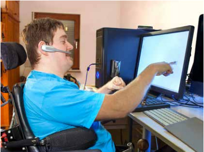 A person with disability uses a computer