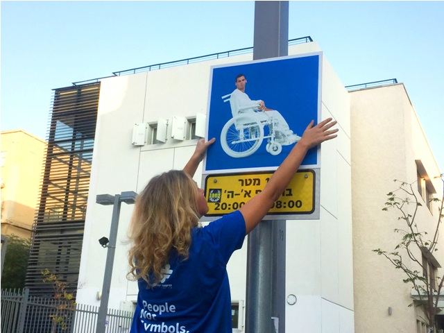 replacing the disabled icon on disabled parking signs with the picture of real disabled people