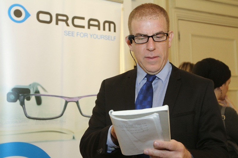 Mr. Gilad Adin tries the OrCam technology